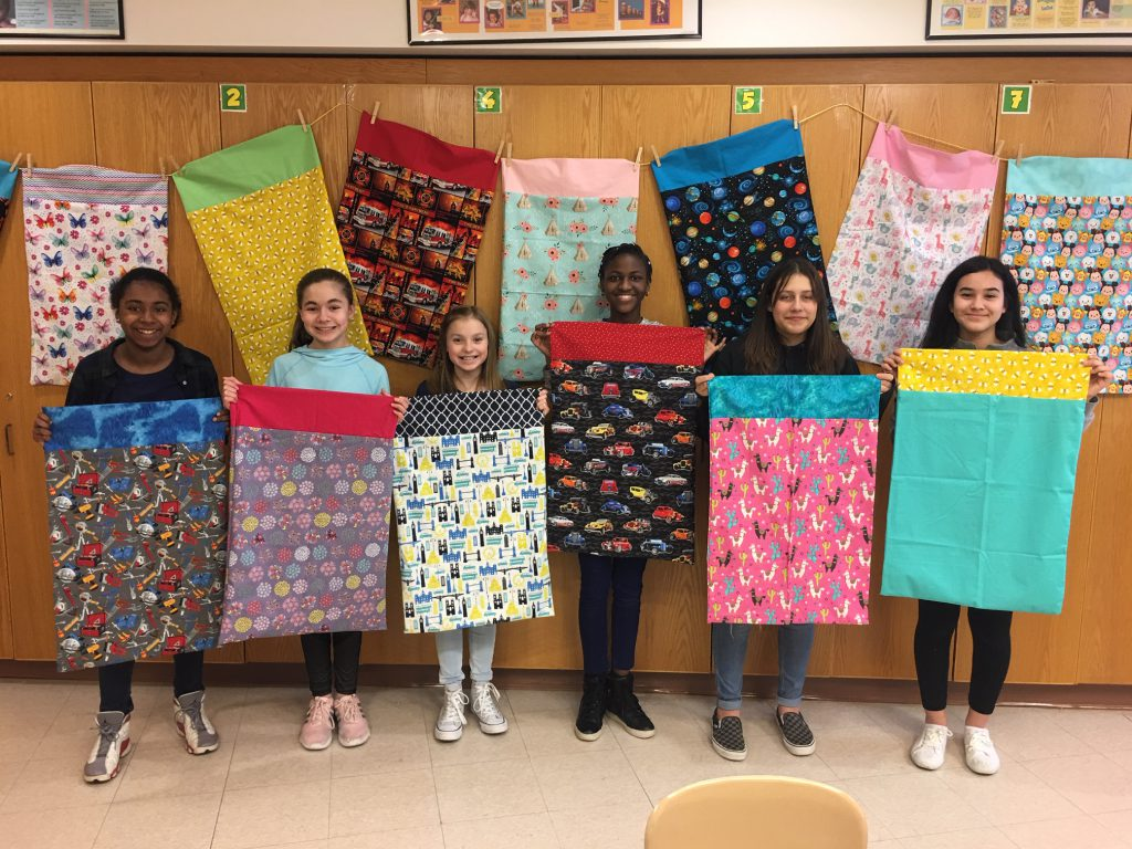 Kids Showing the quilts